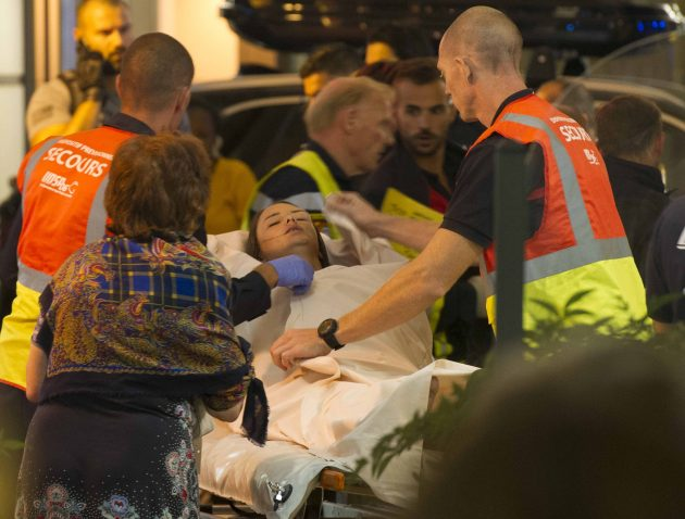 Paramedics rush a young woman to a waiting ambulance July 14 as they evacuate victims from the scene where a truck crashed into the crowd during the Bastille Day celebrations in Nice, France. More than 80 people were killed and the death toll was rising. (CNS photo/Oliver Anrigo, EPA) See POPE-NICE-ATTACK July 15, 2016.
